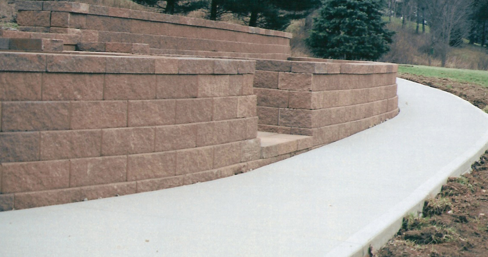 Retaining Wall with Concrete Sidewalk